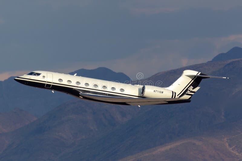 Jet de lujo del negocio de la gama larga de Gulfstream G650 poseído por el aeropuerto internacional de salida Las Vegas de Steve  imagenes de archivo