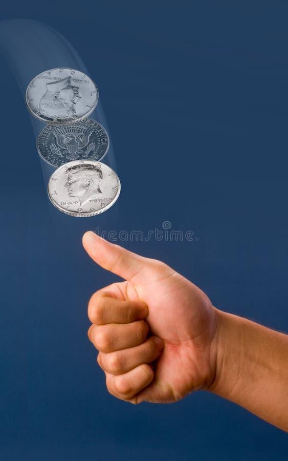 Jet en l'air de pièce de monnaie. photo libre de droits