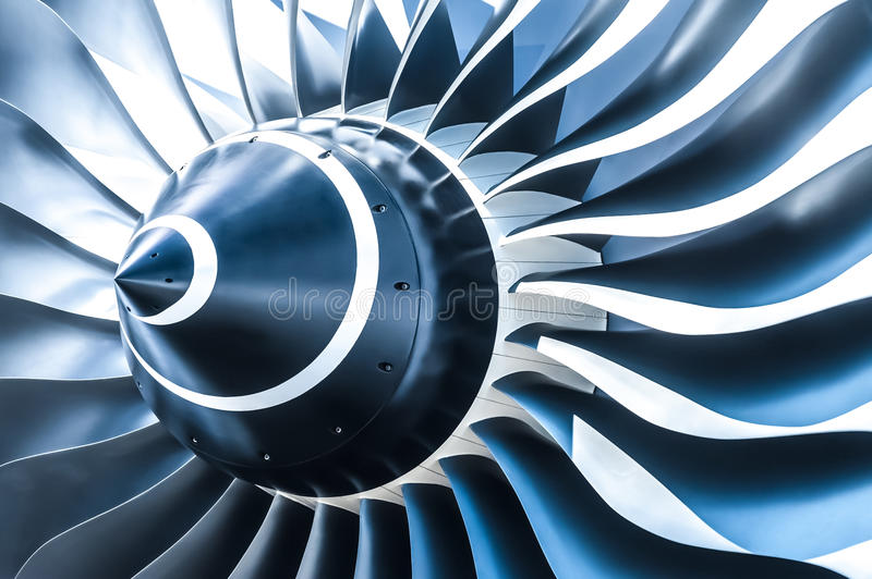 Jet engine. Blue tone jet engine blades closeup royalty free stock photo