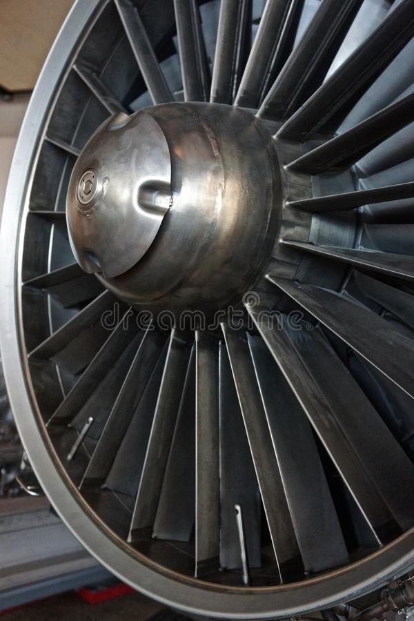 Jet engine intake with baffled and rotating steel structure. A jet engine air intake can be disrupted when foreign matter is pulled into the system stock image