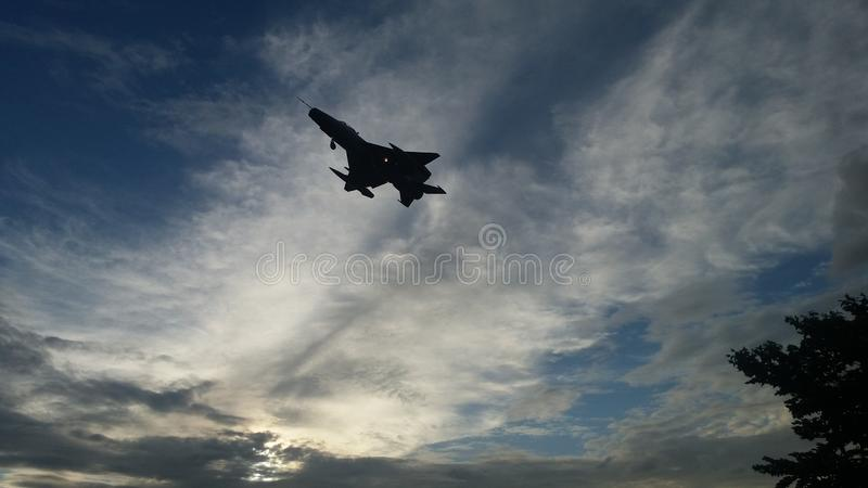 Jet fighter. In a evening sky stock images