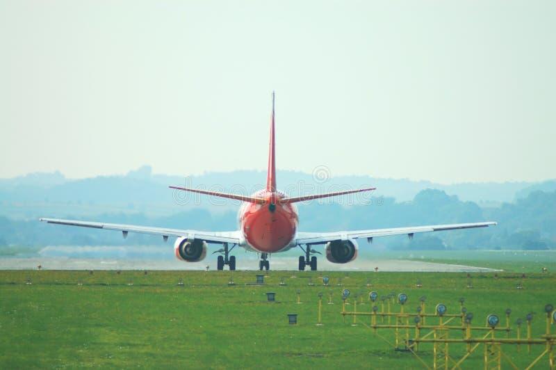 Jet landing royalty free stock photography