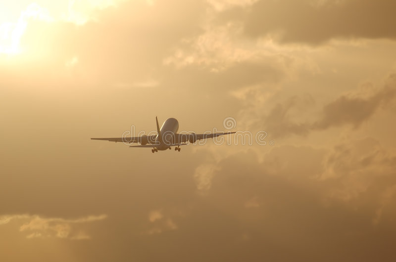 Download Jet Liner Taking Off Against Sunrise Royalty Free Stock Images - Image: 1480469
