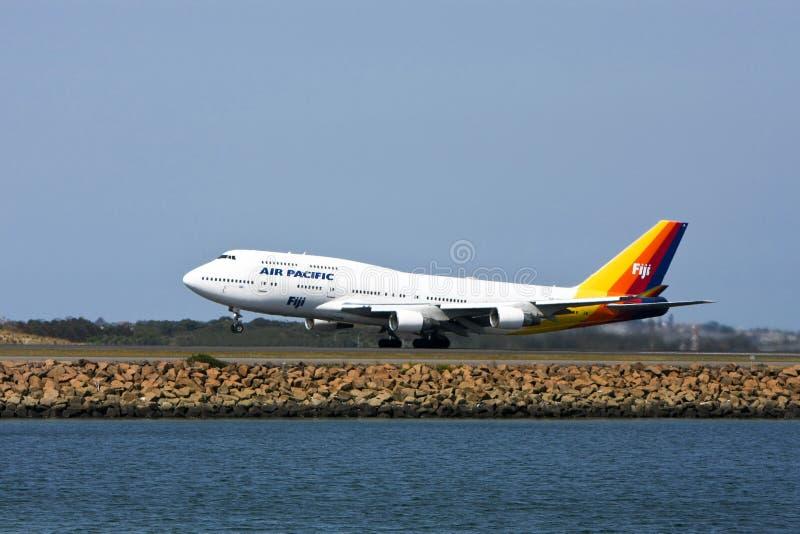 Jet pacífico de Boeing 747 del aire en cauce foto de archivo libre de regalías
