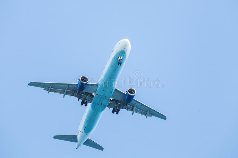Jet plane flying in clear blue sky stock image