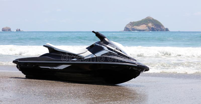 Jet ski at Manuel Antonio national park beach in Costa Rica, most beautiful beaches in the world, surfer beaches in America. Panoramic view of Manuel Antonio royalty free stock photos