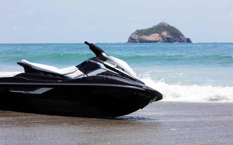 Jet ski at Manuel Antonio national park beach in Costa Rica, most beautiful beaches in the world, surfer beaches in America. Panoramic view of Manuel Antonio royalty free stock photography