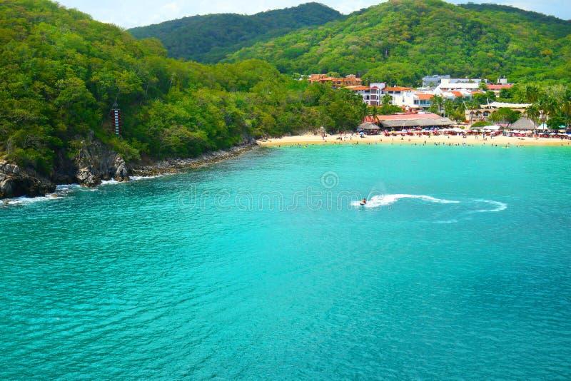 Jet Ski Tourist, Pristine Ocean and Forest. Santa Cruz Bay, Huatulco, Mexico. Sunny Day stock images
