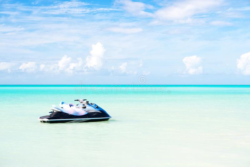 Jet ski on turquoise sea water in Antigua. Water transport, sport, activity. Speed, extreme, adrenaline. Summer vacation on caribb royalty free stock image