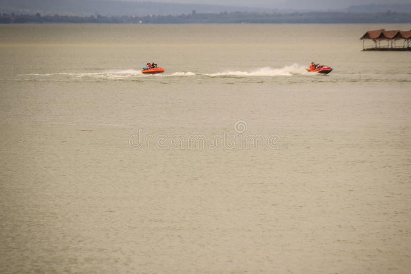 Jet skies and water activities including floating food shop at P royalty free stock photos