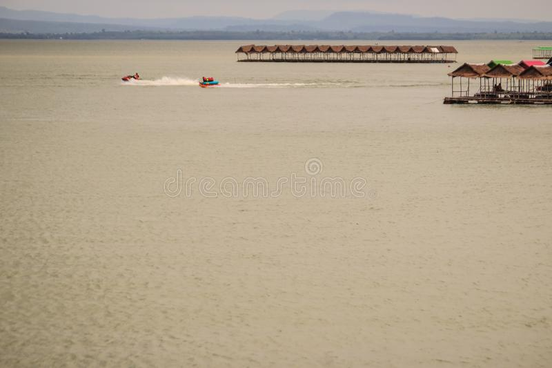 Jet skies and water activities including floating food shop at P stock images