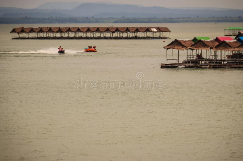 Jet skies and water activities including floating food shop at P stock photography