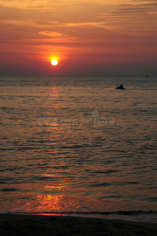 Jet skiing at sunset royalty free stock photo