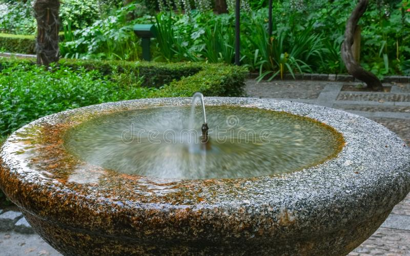 Jet stream of stone fountain drinking water stock photo
