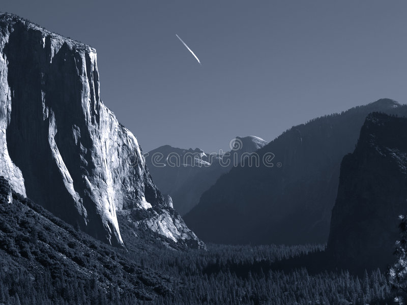 Download Jet trail over Yosemite stock image. Image of eerie, evergreen - 3966743