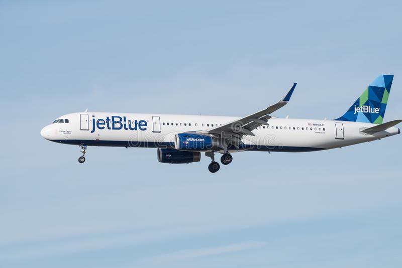 JetBlue Airbus jet approaching LAX for landing. stock images