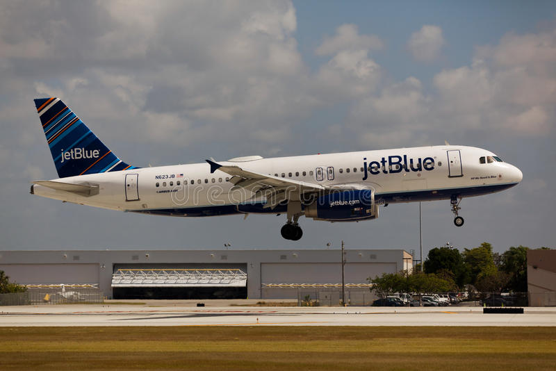 A JetBlue Airbus A320 landing royalty free stock image