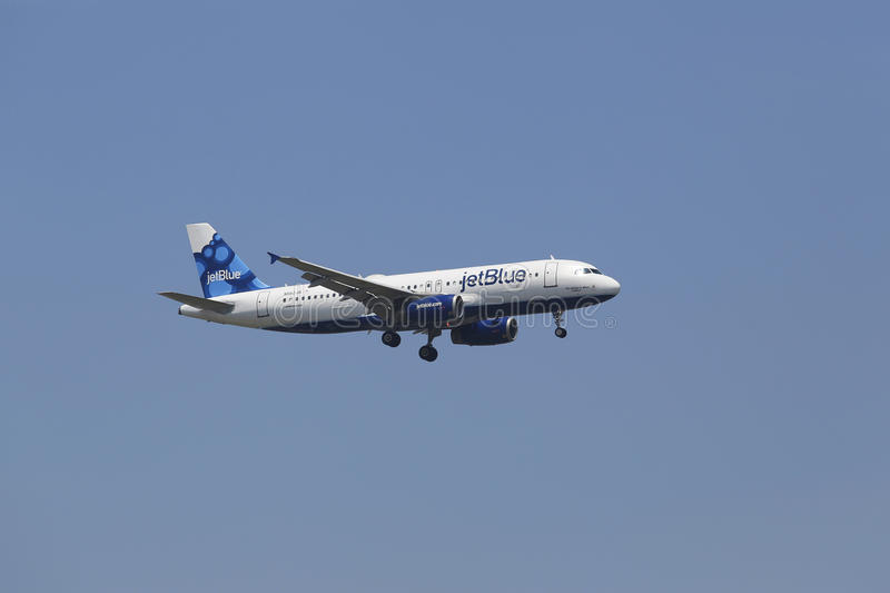 JetBlue Airbus A320 in New York sky before landing at JFK Airport royalty free stock photos