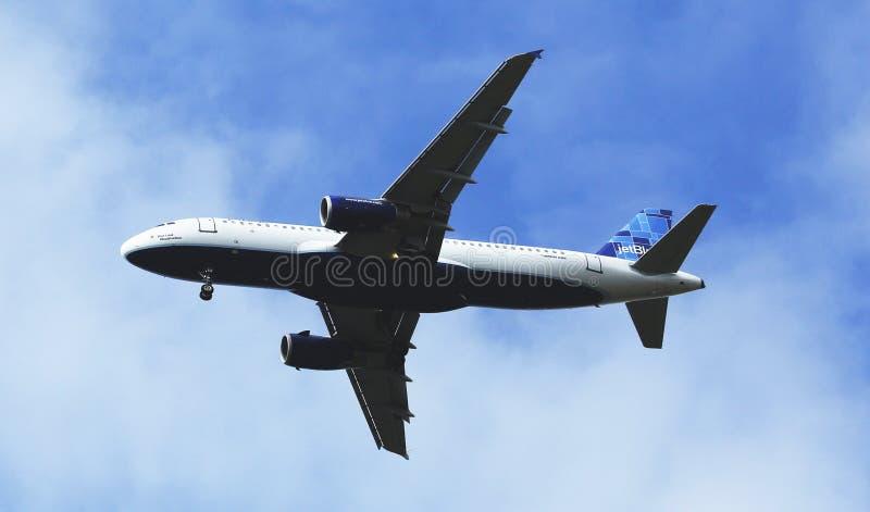 JetBlue Airbus A320 in New York sky before landing at JFK Airport