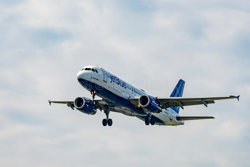 JetBlue Airbus A220 takes off stock photo