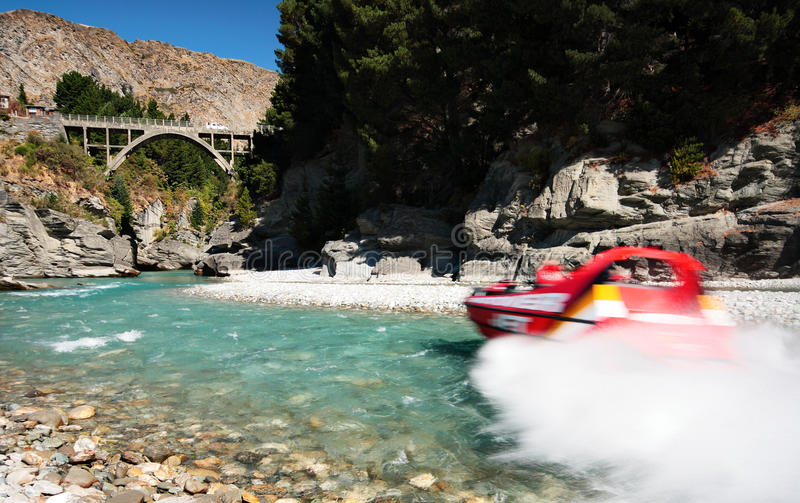 Jetboat on Shotover River. QUEENSTOWN, NEW ZEALAND - FEB 25: A jet-boat is rushing thrill-seekers through the waters of Shotover River on Februrary 25, 2014 near royalty free stock images
