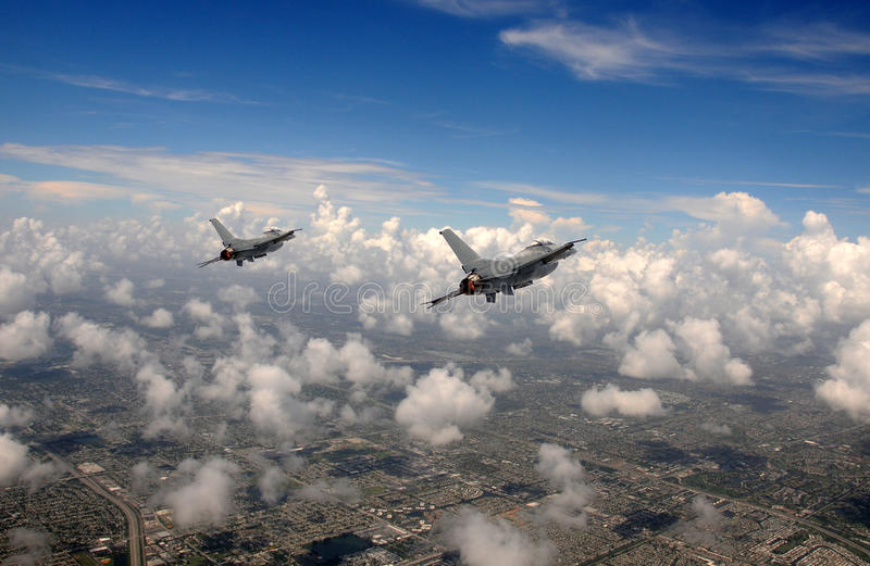 Jetfighter in the sky. Two fighter jets flying at high altitude royalty free stock photo
