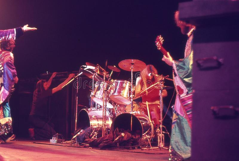 1974. Jethro Tull 08. Denmark, Copenhagen. The picture shows Barriemore Barlow performing a drum solo. To the right Martin Barre plays guitar and to the left stock photos