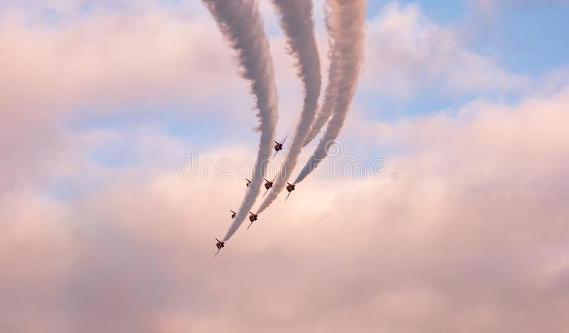Jets fly in formation with colored smoke over Vancouver Harbor royalty free stock photos