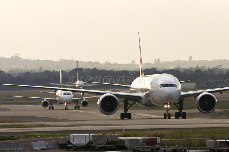Jets lined up at a busy airport stock image