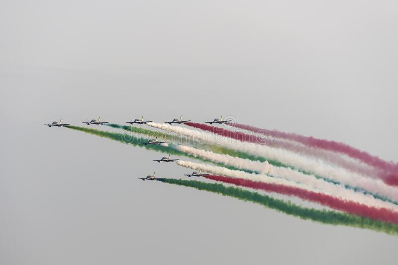 Jets of PAN military team low passage releasing tricolor smokes at airshow, Linate, Italy. LINATE MILAN, ITALY October 12 2019  - military jets of Italian royalty free stock photo
