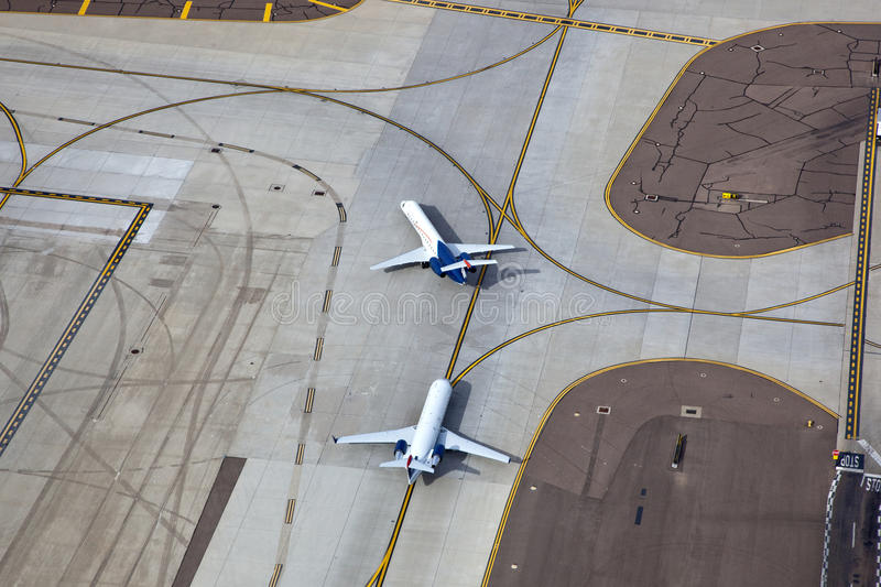 Download Jets on Taxiway stock photo. Image of architecture, plane - 26152572
