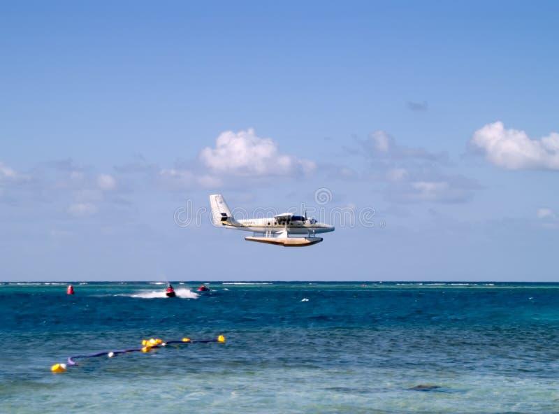 jetski πέρα από seaplane την επιτάχυνση στοκ εικόνες