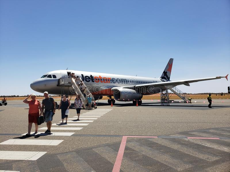 A Jetstar aircraft landed on Ayers Rock Airport in Australia. Photo is taken on 28 Feb 2019, at Ayers Rock Airport in the Northern Territory of Australia. The royalty free stock images