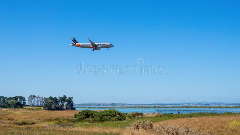 Jetstar airplane is landing at the Auckland Airport stock photos