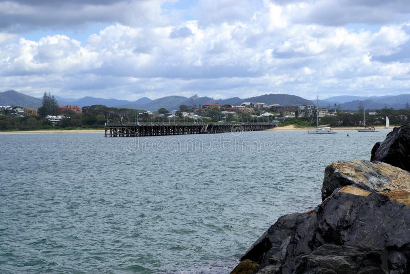 Wide view of Jetty at Jetty beach in Coffs Harbour Australia. Jetty in Australia. Wide view of Jetty at Jetty beach at Australian city of Coffs Harbour stock image