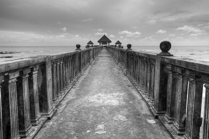 Jetty in black and white royalty free stock image