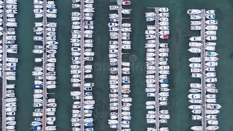 Jetty with boats in marina. At sunset royalty free stock images