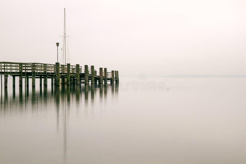 Jetty at lake Chiemsee, Germany royalty free stock photography