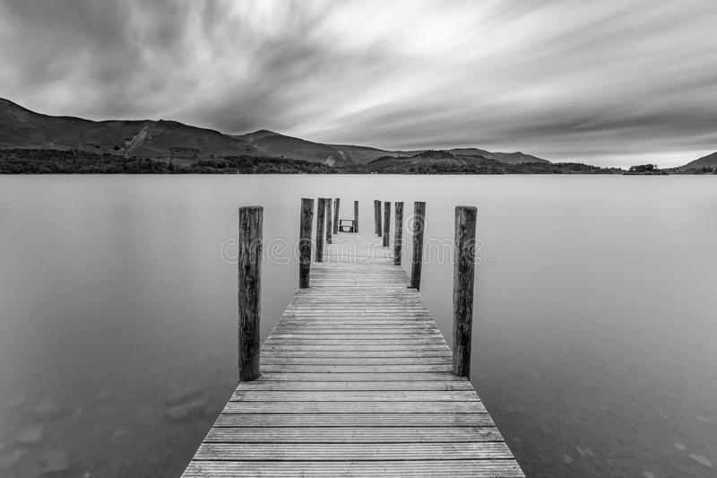 Jetty at lake with moody sky. stock photography