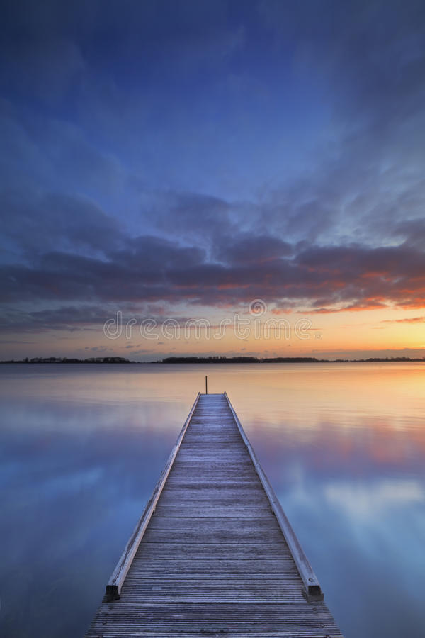 Jetty on a lake at sunrise, near Amsterdam The Netherlands royalty free stock images