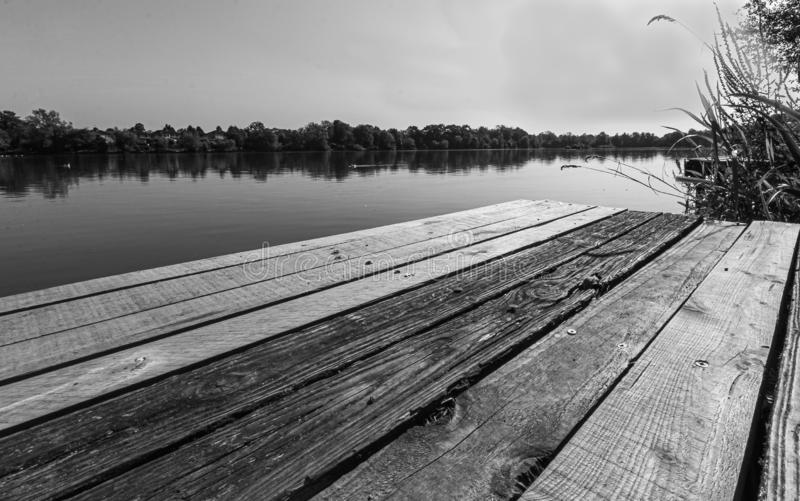 A jetty in mono earls wood solihull West Midlands uk beautiful contrast lake. Stunning beautiful stock image