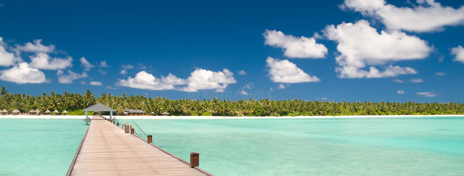 Jetty over turquoise ocean stock image