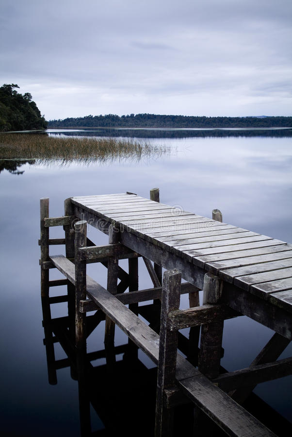 Jetty / Pier Still Water. South of Hokitika on the West Coast of New Zealand's South Island, Lake Mahinapua is a serene escape stock images