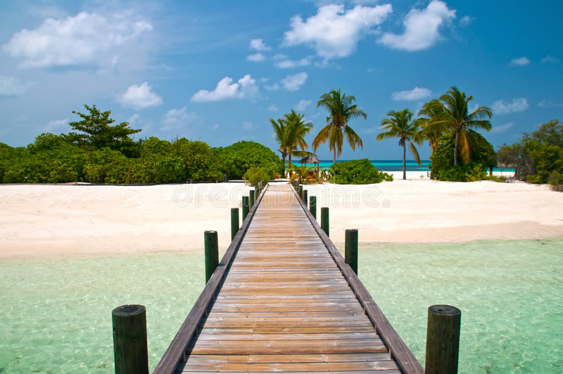 Jetty to an tropical island stock photos