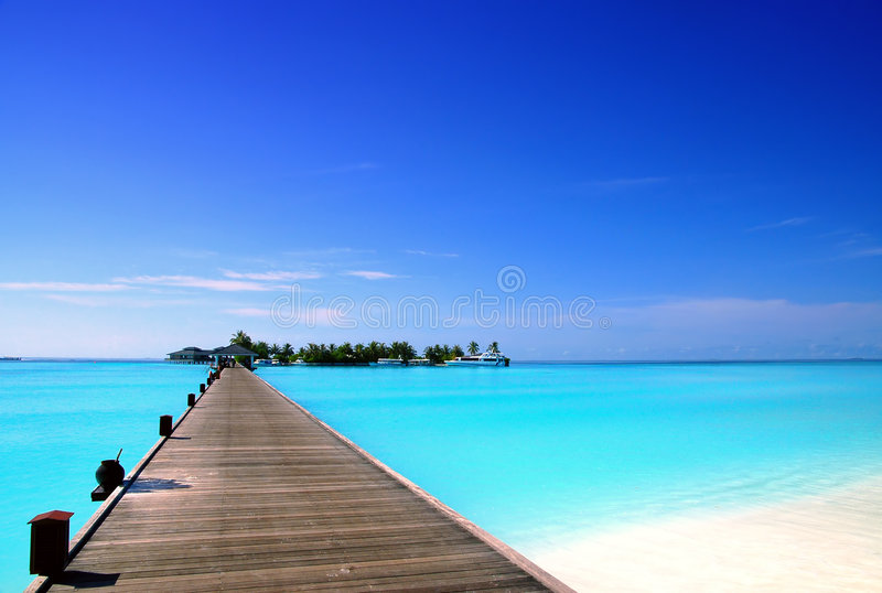 Jetty to an tropical island stock images