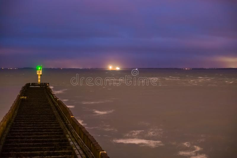 Jetty in the water leading to a small watchtower, seascape of vlissingen, zeeland, The Netherlands royalty free stock images