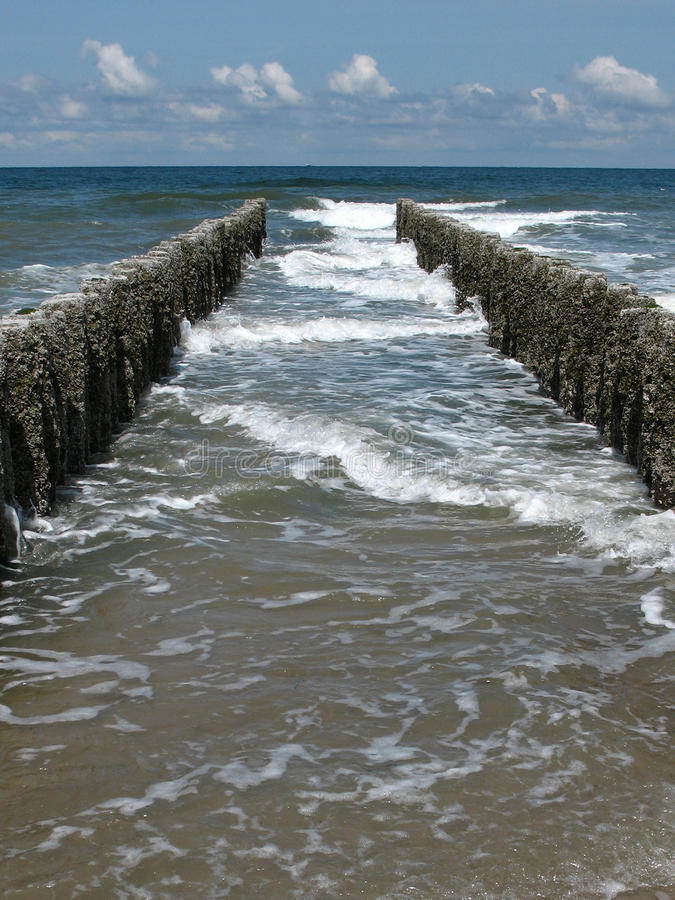 Jetty wooden poles royalty free stock image