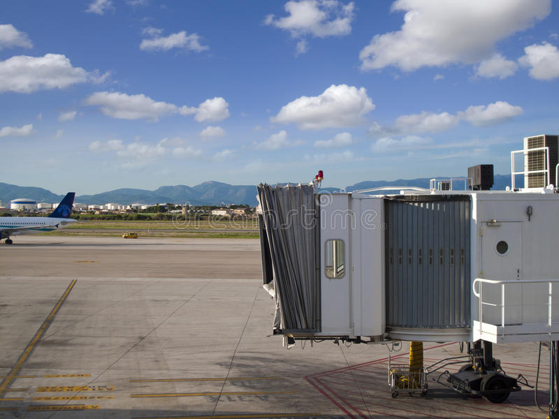 Jetway on airport tarmac royalty free stock image