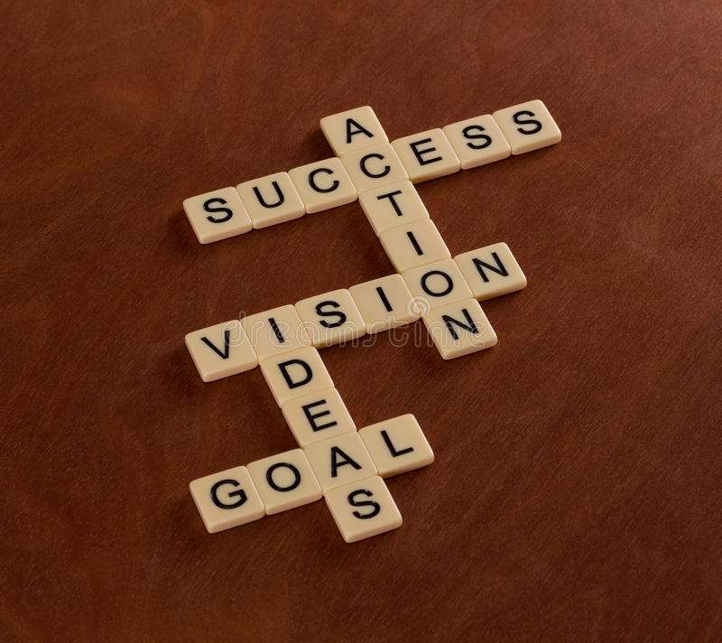 Jeu de mots croisé avec des mots but, idées, vision, action, succès photo stock