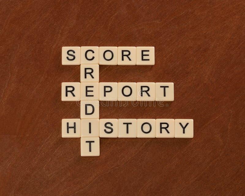 Jeu de mots croisé avec le crédit de mots, histoire, rapport, score cred images stock